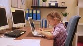 Cute little girl working on the laptop, typing something on computer, modern education in the elementary school, study with pleasure Wideo