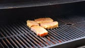 proteins : Juicy steaks sizzle on flaming  smoking grill