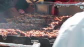 broiling : Juicy roasted chicken skewers,made of white meat and bacon, being turned on the bbq Stock Footage