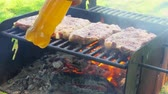 étvágygerjesztő : meat roasting on an open fire pork steak on an open fire 4k