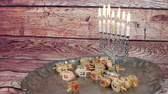 zázrak : Jewish holiday Hanukkah creative background with menorah. View from above focus on .