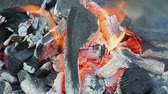 wood grill : Burning charcoal with orange-colored flame and glow Selective Focus, Focus on parts of the charcoal pieces around the flame Stock Footage