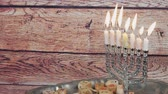 brožura : Jewish holiday Hanukkah creative background with menorah. View from above focus on .