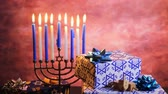 kasım : Jewish holiday HanukkahBeautiful Chanukah decorations in blue and silver with gifts