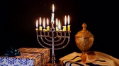 menora : jewish holiday Hanukkah with menorah over wooden table Wideo