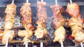 brasileiro : Meat roasted on fire barbecue kebabs on the grill