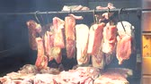pork meat : Smoking pork meat, bacon and sausages, food preparation process of cured pork meat delicacy in smokehouse.