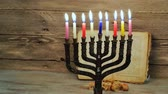 wiara : abstract retro filtered low key image of jewish holiday Hanukkah with menorah traditional Candelabra