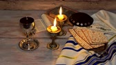 matza : Shabbat candles in glass candlesticks with blurred covered matzot Stock Footage