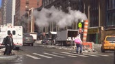 NEW YORK CITY - january 16, 2018 Steam pipe releasing hot air into the street in Midtown Manhattan.
