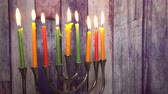 religious symbols : abstract retro of jewish holiday Hanukkah with menorah traditional defocused lights Selective soft focus