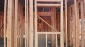 переделывать : Building construction, wood framing structure at new property development site
