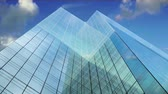Glass Office building with reflection of sky and clouds