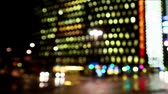 Blurred city traffic at night seen from moving vehicle Stok Video