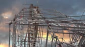 Low angle view of scaffolding on blue and orange sky Stok Video