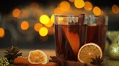 warme thee : Mulled wine  in night celebration of  New Year party and delicious Christmas drink for autumn and winter season , 4k Dci resolution Stockvideo