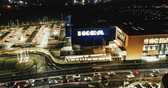 main entrance : Sheffield, UK - 16th December 2019: 4K Aerial night time lapse of the front of Ikea in the middle of the city of Sheffield as traffic builds up outside during rush hour Stock Footage