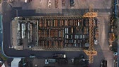 zinco : Sheffield, UK - 16th December 2019: Aerial view of steel pipes in outside storage being collected with a forklift truck in Winter