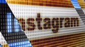 Instagram in the blue screen.  Instagram is free application for sharing photos and videos.