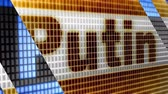 The surname of Vladimir Putin, the President of Russian Federation, on the blue screen macro.