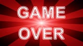 끝 : Game Over icon in red abstract background with rays. Looping footage with Prores 4444 and 4K resolution.