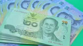 Thai banknotes on green background