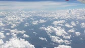 color image : view from aircraft window with blue sky and clouds