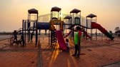 oyun alanı : Time lapse of children play at playground with sunset sky in Chonburi, Thailand