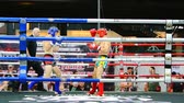 maç : BANGKOK, THAILAND - 15 MAR : Unidentified kick boxing fighter fighting at boxing ring on 15 March 2019 in Bangkok, Thailand Stok Video