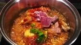 curry : Hot boiling Ramyeon noodle Kimchi Chigae soup with beef top view - Korean home cook cuisine