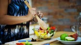 женат : Locked and close up shot with female hands are cooking salad vegetables in big glass bowl
