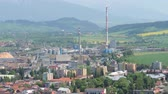View over small industrial town Ruzomberok (Slovak Republic) with High Tatras mountains in the background