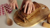 sekaná : Home cook cutting meatloaf on a wooden board