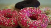 fattening : Bright appetizing donuts on a wooden table. Close-up. HD