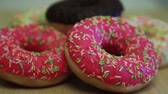 fattening : Many delicious donuts lie on a light table
