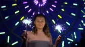 mischief : A beautiful girl is happy with a holiday with fireworks in her hands. slow motion.