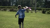 aviador : The boy launches a toy plane in the park in sunny weather having a good mood. slow motion. Stock Footage