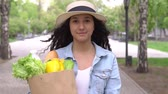 nutricional : Young beautiful woman carries a bag with products in a good mood. Slow motion