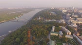 unutulmayan : Aerial urban view. Flying near a big river at historic area of Kiev. Aerial sightseeing of ukrainian capital Stok Video