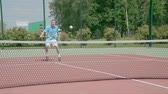 saraivada : Tennis player hit a drop shot. Ball softly falls just after the net. Slow motion