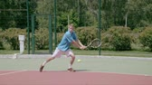 saraivada : Two-Handed Backhand. The player tries to catch the ball. Slow motion