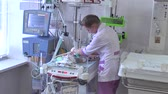 baba : Newborn babies after heart surgery at reanimation section. Nurse being taken care of baby