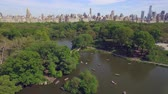 parkosított : Flying above the Cental park in New york city. Amazing aerial picture. (80 m) Aerial view of Central Park in New York City. Drone filming. Stock mozgókép