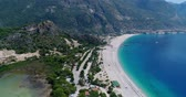 paragliding : Aerial. Flying above Oludeniz beach. Beautiful Bay with crystal water. Turkey. 4K.