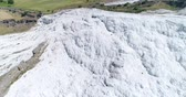 pamukkale : Aerial. Pamukkale - famous gleaming white calcite travertines on the cliff.