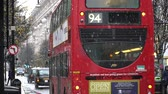 cabine telephonique : London,UK - 12-09-17: Routemaster is the one of Transportation in London. Red Bus and Black Cab in snow day at central London around Oxford street. Vidéos Libres De Droits