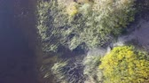 Aerial View. Flying over the beautiful autumn River. Aerial camera shot.