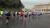 Rome, Italy - April 2, 2017: Via del Teatro di Marcello, participants in the 23 ^ Rome Marathon through the streets of the capital Following the street circuit.
