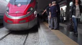 Naples, Italy - May 16, 2017: The high speed passenger train just arrived at the Central Train Station in Naples, the people who got off the train headed for the exit. Passengers get off the train and head to the station exit Stok Video
