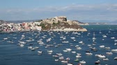 Procida, Punta Monaci and the castle. Isle of Procida, Gulf with moored boats. In the background Punta Monaci and the castle. Stok Video